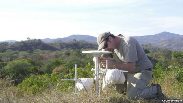Andrew Newman, an associate professor in the School of Earth and Atmospheric Sciences at the Georgia Institute of Technology, performs a GPS survey in Costa Rica's Nicoya Peninsula in 2010. (Lujia Feng/Georgia Tech).
