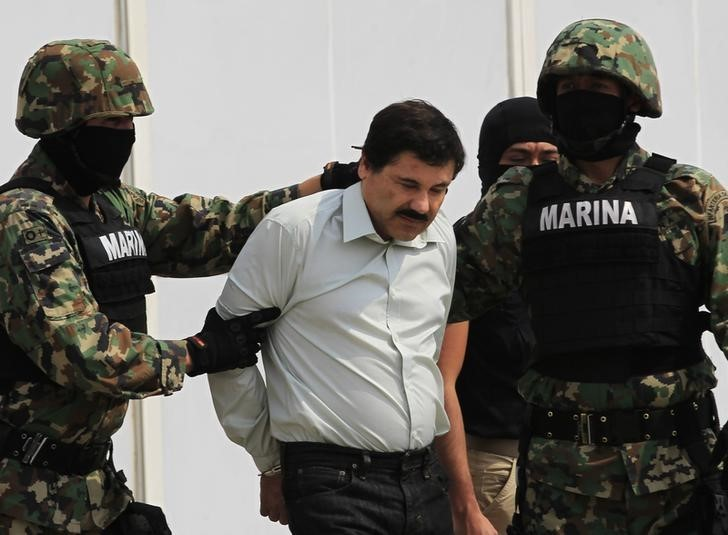 "February 22, 2014: Joaquin ""Shorty"" Guzman (C) is escorted by soldiers during a presentation at the Navy's airstrip in Mexico City (REUTERS/Henry Romero)"